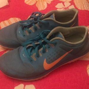 Blue and Orange Nike Sneakers
